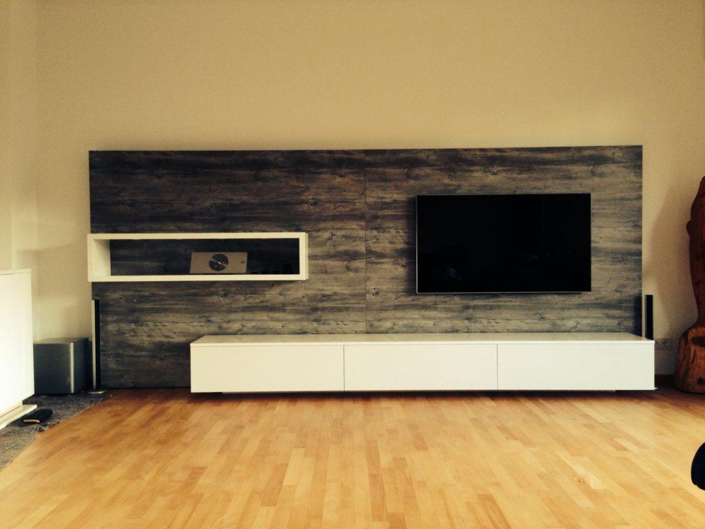 Das Foto zeigt eine Wohnwand, welche aus einem 3D Entwurf vo unserer Tischlerei gebaut wurde.